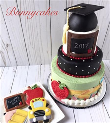 Three-tiered graduation cake and cookies