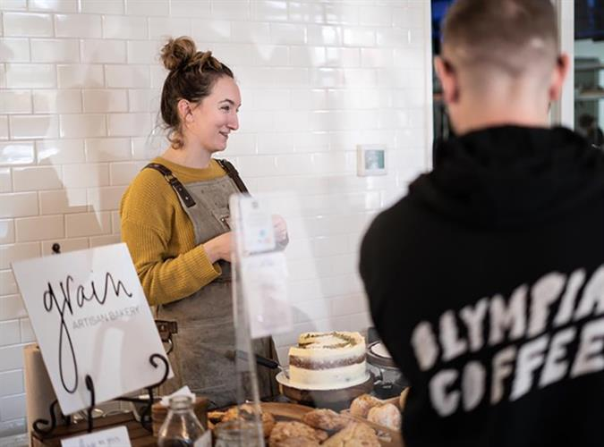 Owner and Pastry Chef of Grain Artisan bakery Lauren Sophia Anderson at a pop up market. Photo credit: Danny Willis of Bravata